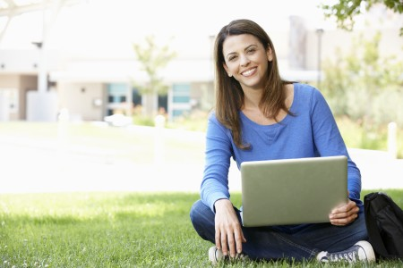 woman in blue shirt with a laptop