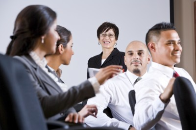 Men and woman employees discussing loyalty
