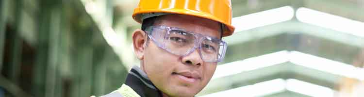 Construction worker with safety glasses